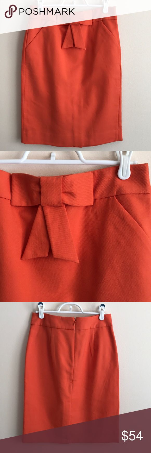 """Jcrew orange double serge bow pencil skirt Jcrew orange double serge cotton bow pencil skirt, a lighter orange than turned out in pics, 22"""" long and waist measures 14"""" across, pockets still sewn shut but can be opened - perfect condition never worn J. Crew Skirts Pencil"""