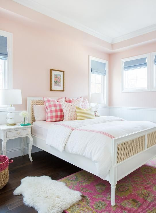 harbour-cane-bed-pink-buffalo-check-pillows-white-abacus-lamps