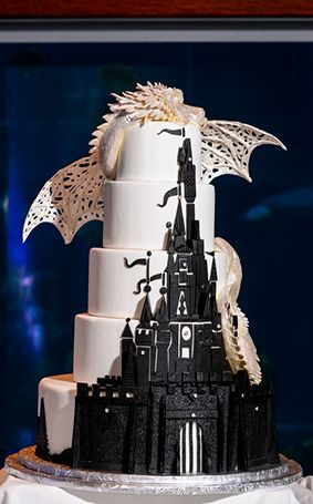 Black and white fantasy style wedding cake - complete with castle and dragon! // Disney Weddings