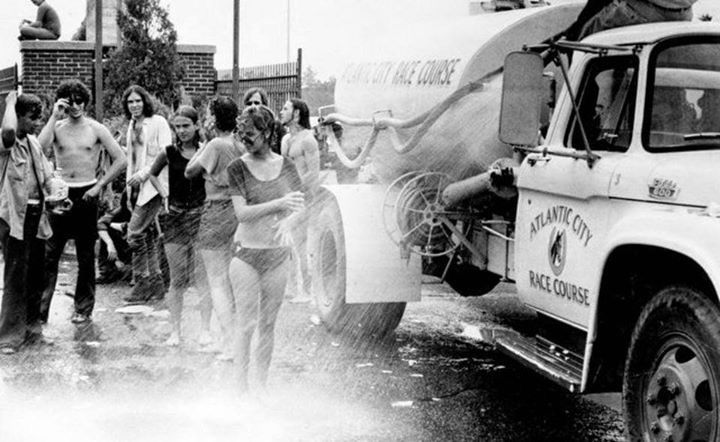 Photo #2 - New Jersey's version of Woodstock was the Atlantic City Pop Festival, held Aug. 1 to 3, 1969. In the first image, a water truck provides some cooling to some of the thousands who attended. Star-Ledger archive photos.