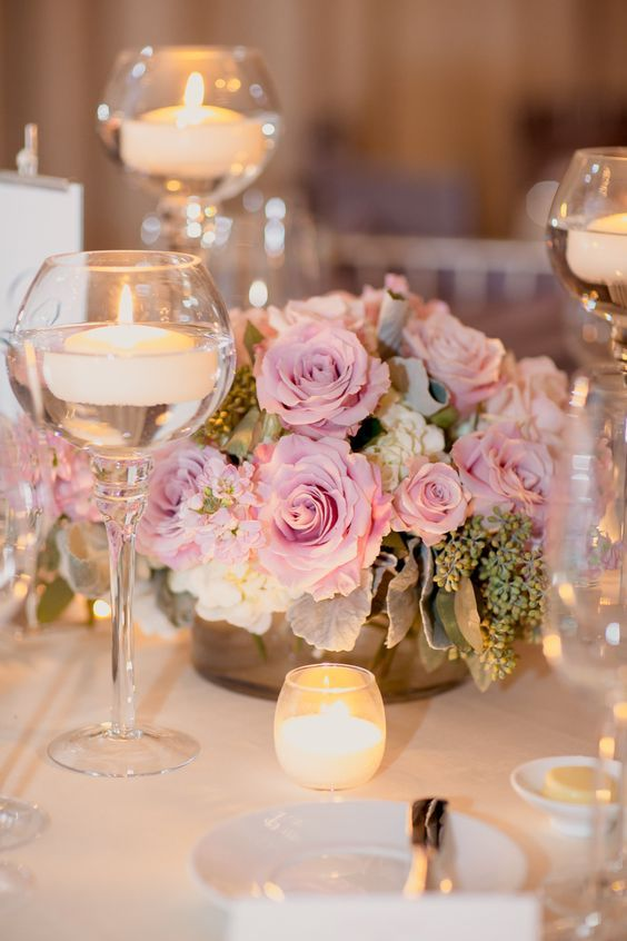 pink flowers and candle wedding centerpiece