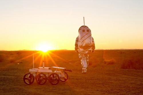 Aouda.X Mars spacesuit together with MAGMA Whiterover during sunset. The Life experiment of the University of Innsbruck is attached to the rover. Credit: (c) OeWF (Katja Zanella-Kux)