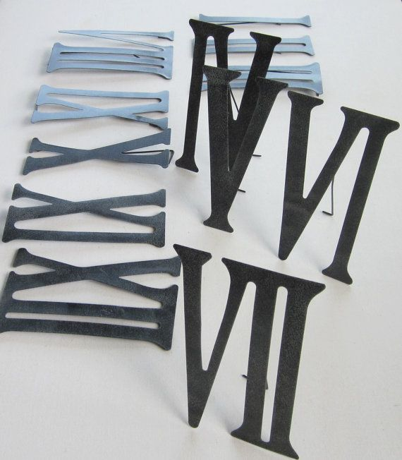 Roman Numerals Metal Numbers 1 to 12 by GardenBarn on Etsy; I am going to make my own oversized wall clock using these roman numerals.