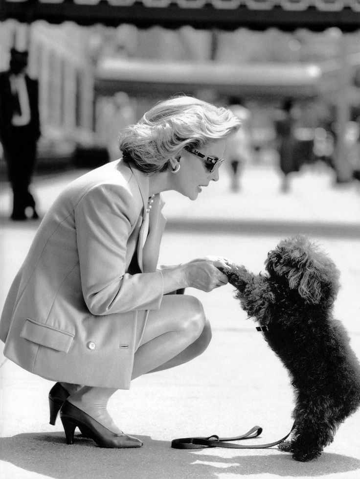 Carolina Herrera with her poodle Alfonso, photographed by Antoni Bernad, 1993.