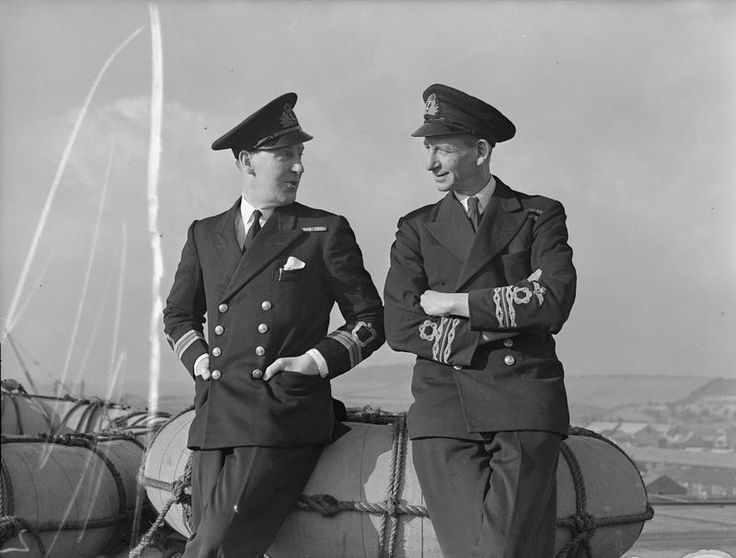 NAVAL ENGINEER AND DOCTOR WITH WINGS. 11 FEBRUARY 1944, ROSYTH. THESE TWO NAVAL OFFICERS, ONE AN ENGINEER, AND THE OTHER A DOCTOR, BOTH SERVING IN AN AIRCRAFT CARRIER WEAR FLEET AIR ARM WINGS ON THEIR SLEEVES. THEY DON'T FLY NOW, BUT FLEW IN THE ROYAL NAVAL AIR STATION IN THE LAST WAR.