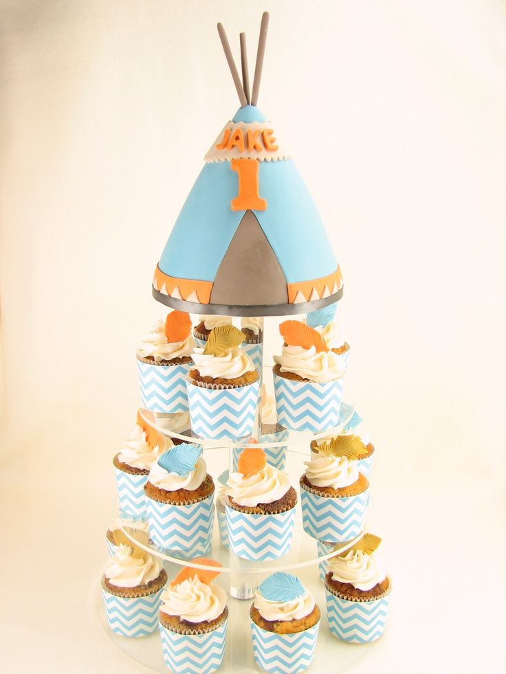Chocolate/Vanilla marble cupcakes and teepee with fondant feathers. The colours matched Jake's birthday invitations. www.facebook.com/cakesbyleannerhodes