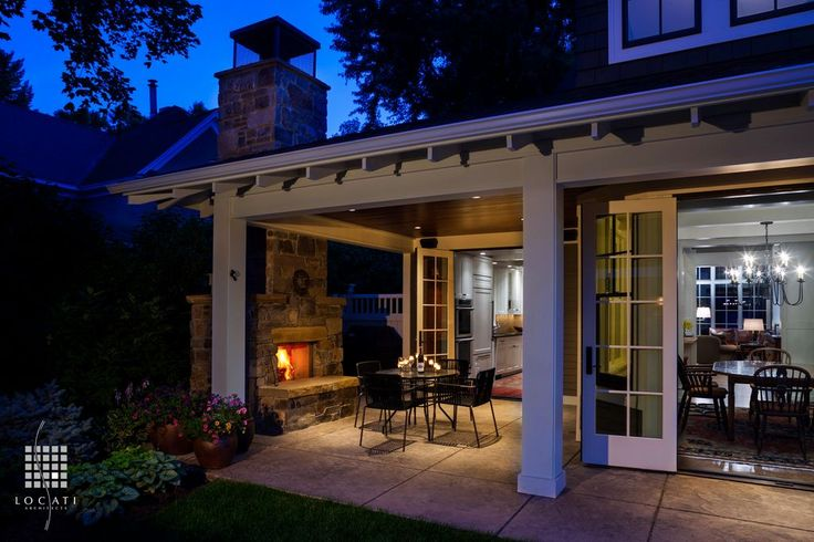 Craftsman Porch with outdoor pizza oven, exterior tile floors, French doors, Wood paneled ceiling, Covered patio, Fence