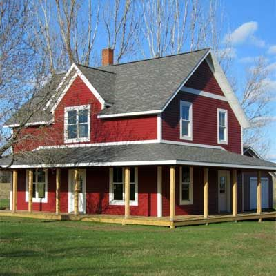 Once a stark white box, this cheery farmhouse got a new foundation, roof, siding, and wrap-around porch making it a focal point in the community. | thisoldhouse.com