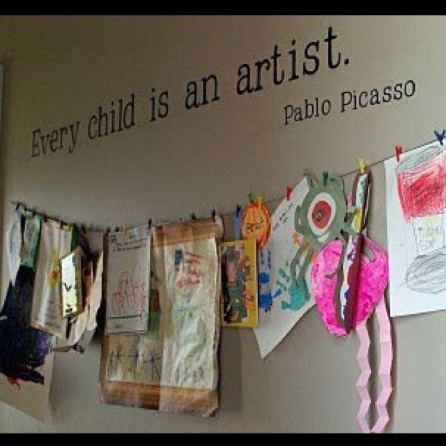 Cute way to display children's artwork.