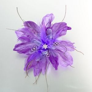 "This beautiful 6"" purple feather clip/pin is a perfect accent for hair, clothing and other accessories. Both a metal hair clip and a pin are found in back for easy attaching."