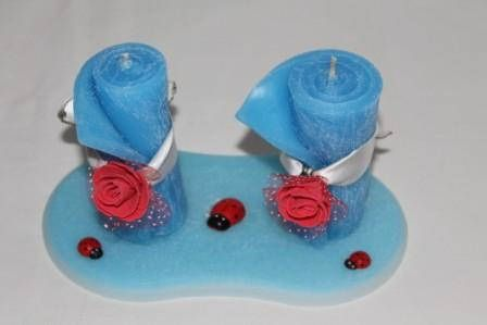 https://flic.kr/p/Bx5c4W   CENTREPIECE – MADE OF WAX   Centerpiece made of wax, composed of two rolled light blue candles (in the size of 45 x 95 mm and adorned with red felt roses) above an oval two-coloured (light blue and white colours) plate in the size of 180 x 90 mm and decorated with three plastic ladybugs. 100% natural essential oil with lemon fragrance.  Handmade.  Read more:   www.ilmiomondoincera.com