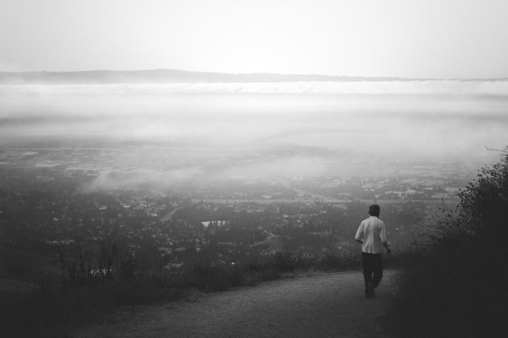 Mission Peak in Fremont, California. It was almost dawn, fog was still covering up the city like a blanket while this old asian man was enjoying the morning breeze lost in his thoughts.