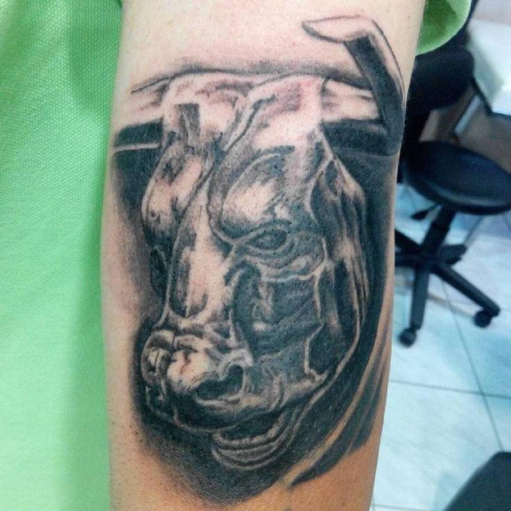 realistic animal bull statue tattoo