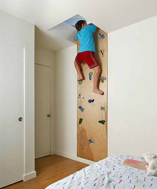 Cool bedroom design idea at Feldman Architecture. Having a climbing wall in your bedroom is cool but having a climbing wall that leads somewhere (to the next floor, actually) is way cooler. This creates an incentive to climb and provides exercise in the process. What a neat idea!