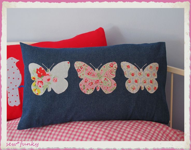 Appliqué butterfly cushion in denim, only an image but can probably find an image on circuit to use as a template! cute idea