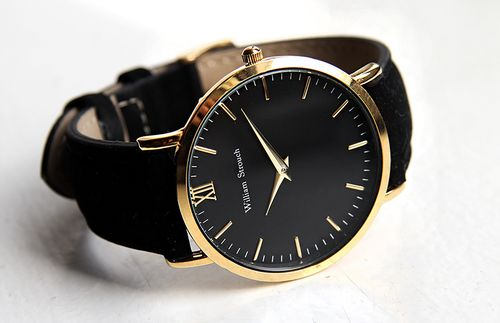 Luxurious Swiss designed black and gold stainless steel watch with a soft…