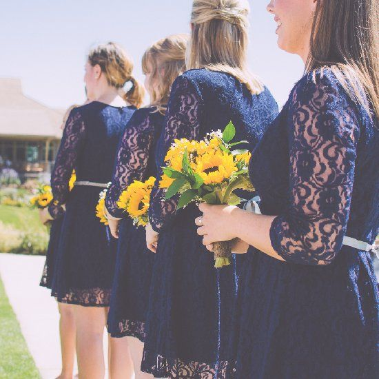 Gorgeous navy, yellow, and white Colorado wedding filled with rustic pine cone and birch tree slab centerpiece decor!