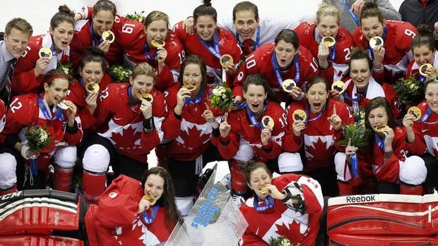 Canadian women's hockey team celebrate after beating the USA 3-2 to win the women's gold medal ice hockey game in overtime at the 2014 Winter Olympics, Thursday, Feb. 20, 2014, in Sochi, Russia