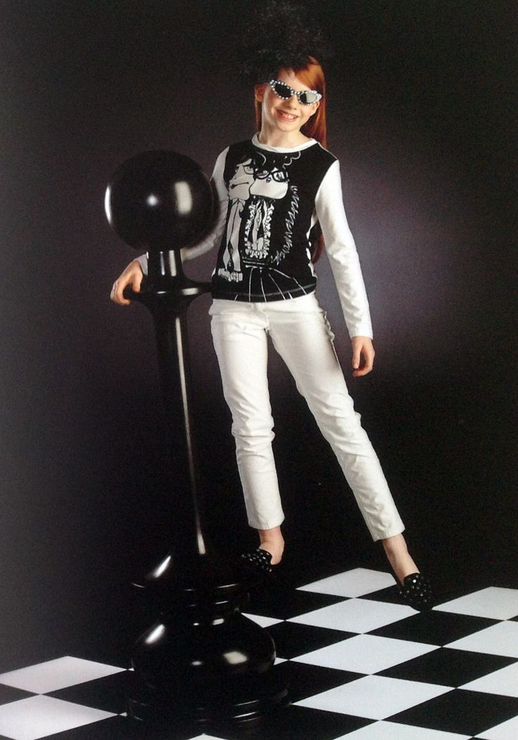 White pants and T-shirt by Moschino