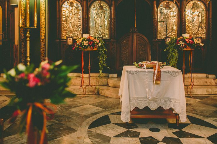 Matching the candle holders with the colors of the church emphasizes to the colors of the flower decorations.