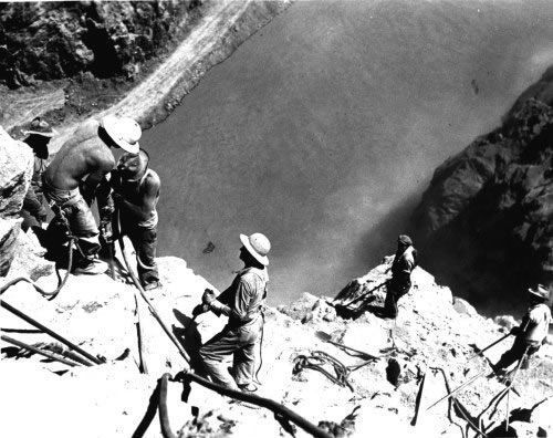 """The """"High Scalers"""" toiled some 800 feet above the Colorado River during construction of the Hoover Dam. Some were former circus acrobats. Their job was to clear the walls of the canyon with jackhammers and dynamite."""