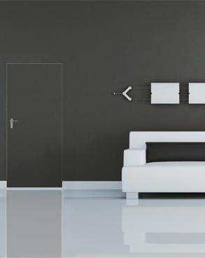 Deuren bepalen het uitzicht van je interieur. Goed nadenken dus! Foto: www.argentalu.com (zwarte binnendeur • woonkamer • witte sofa)