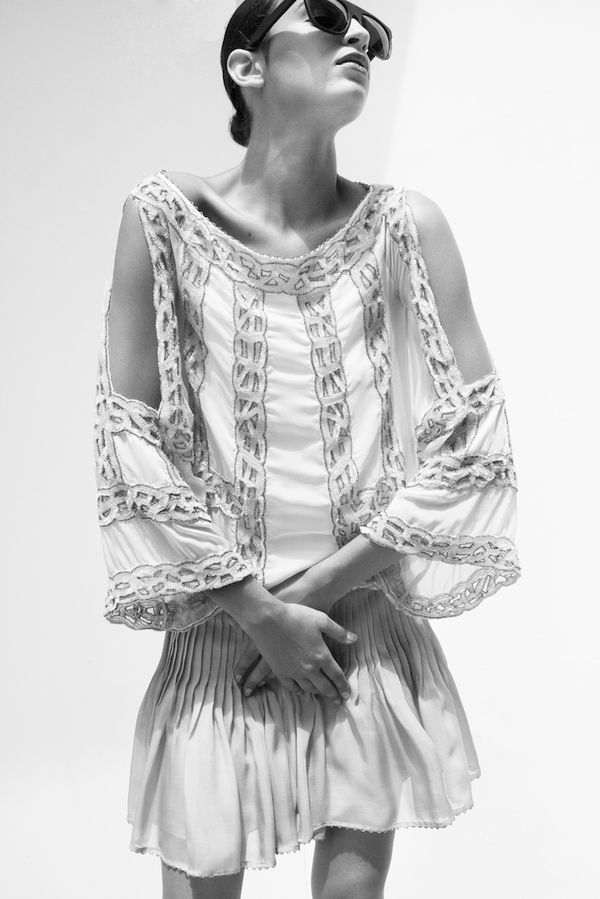 This Blumarine degradé dress has just arrived at Splash Beach. It features a rounded neckline in shades of ivory and soft pink with sequin embroidery in chain motive and wide three-quarter sleeves with splits on the side. Photography by Filep Motwary