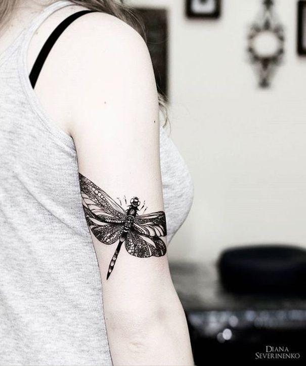 dragonfly tattoo on arm