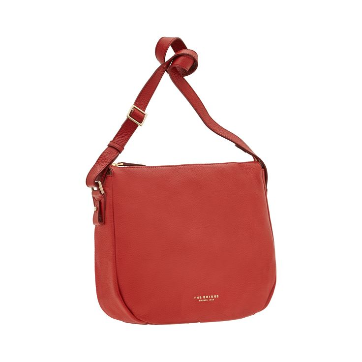 This leather shoulder bag from The Bridge features a no-frills, practical design. Minimal and classy, this bag is the perfect accessory for a casual chic outfit. Zipper closure. Size 32X29X10 cm.