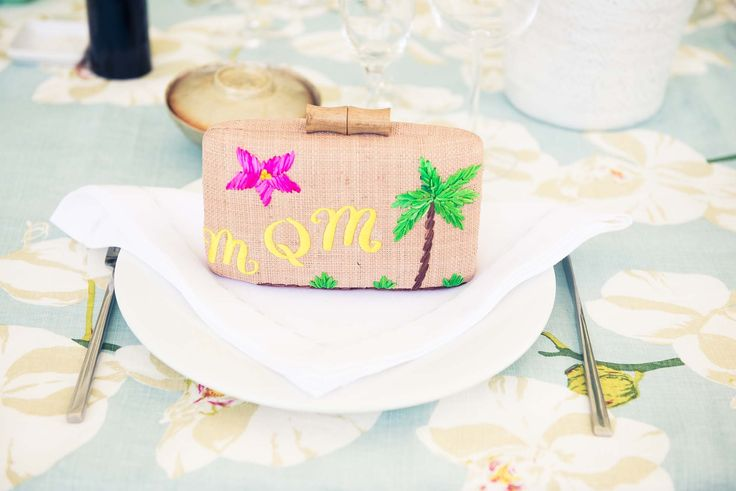 My mom organized the most amazing luncheon for my eleven bridesmaids and me. orchids to  tablecloth, pearl jewelry bowl with a small bracelet inside. I set each place setting with a custom Kayu bag, monogrammed with each girl's initials.