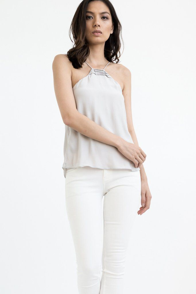 """DETAILS:  2 in 1 CAMISOLE is designed to be worn two way: front and back Darts near breast area Modern trapezium neck linewith our NEVILLEE signature design  FIT:  Relaxed fit For a super relaxed fit stick to your regular sizingOR fora fitted look (around the body), go a size down.  Elisewears size XS. She is 5'7,"""" Bust 33,"""" Waist 25,"""" Hips 35"""" FABRIC:  Pre-shrunk 100% Premium Diamond Wash Silk® - super soft silky touch. Silk is light-weight and breathable which means, cooling in the…"""