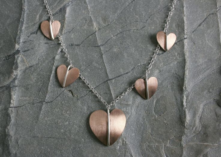 A very sweet silver and bronze necklet on silver trace chain.   #bronze #heart #necklace #pendant #silver