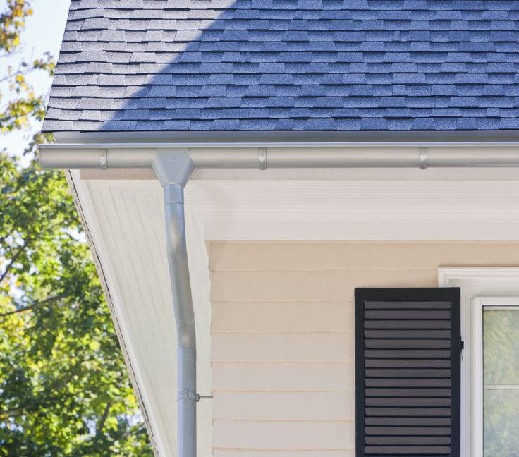 RHEINZINK Half round gutters - evacuates water much quicker.  PrePATINA blue-grey.