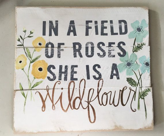 She is a Wildflower wood sign by HelloShoppe on Etsy