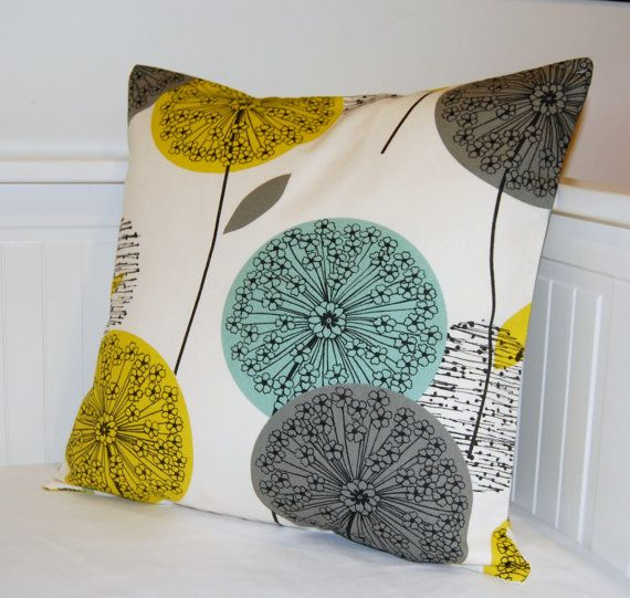 This 16 inch ( 40 cm ) decorative pillow cover has teal, grey and mustard yellow dandelion flower heads and leaves on a soft white / cream