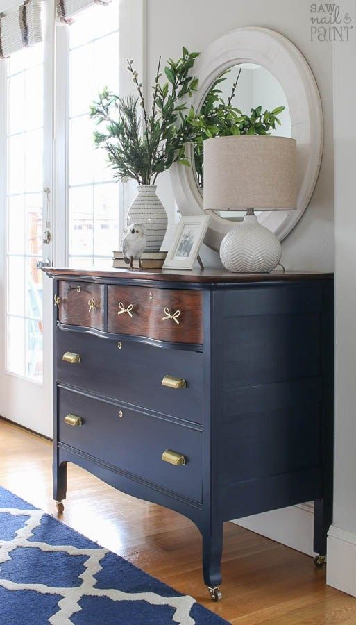 Before and after makeover of a vintage serpentine dresser using General Finishes milk paint in Coastal Blue, antique walnut stain, and new brass hardware.