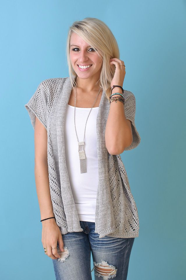 Short sleeve textured open cardigan. Grey