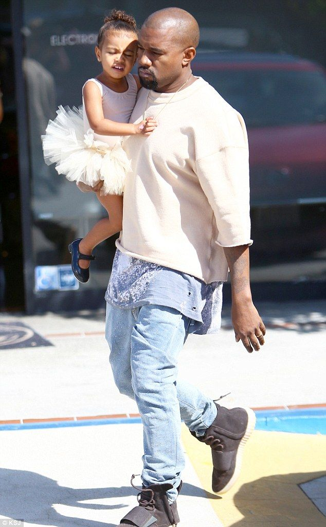 Stepping in: Kanye West has reportedly been taking care of his daughter North as well as sister-in-law Kourtney's three children while the family stay in Las Vegas. He is pictured last week taking his little girl to her ballet class