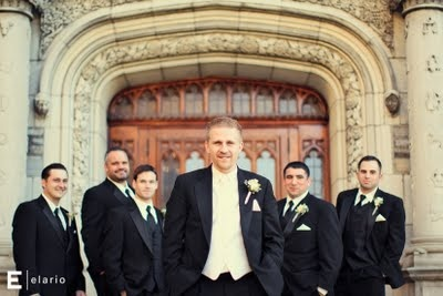 Guys in black tuxes.  Groom in white tie and vest, groomsmen in black ties and vests.  Scott wedding, photo by Elario.