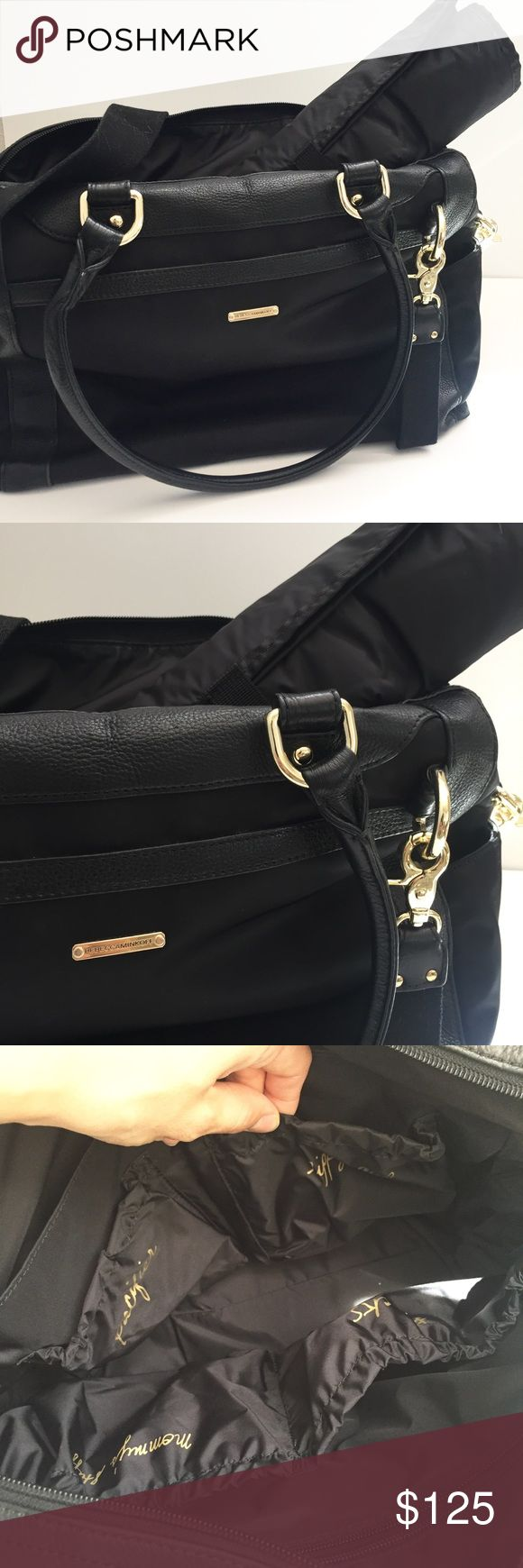 "Rebecca Minkoff Knocked Up diaper bag The perfect diaper mom for the fashionista mom! Gorgeous! Discreet! Fits everything you need! No major markings. No tears. Great condition. Only used for 8 months. Comes with messenger strap and changing pad.  Black with gold hardware My rough measurements: 17""(w) x 11""(h) x 6""(w) Original $345 Rebecca Minkoff Bags"