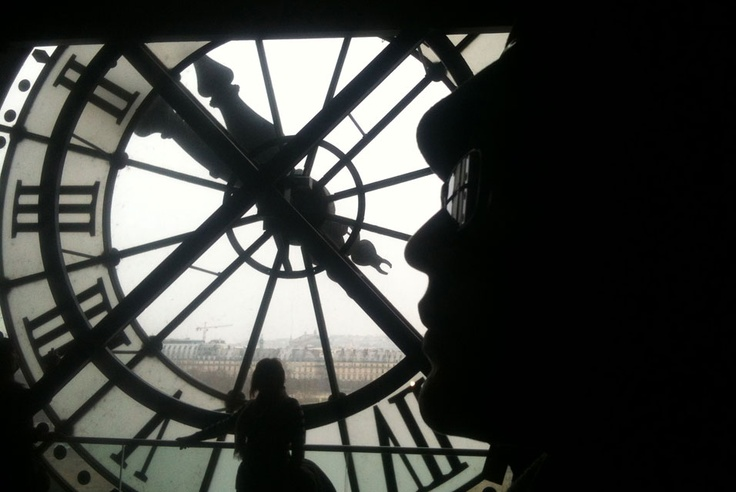 PARIS.- A woman looks at the Seine River through the giant clock in the Orsay Museum in Paris on April 5, 2013. In 1977 the French Government decided to convert Paris railway station and hotel, built in 1900 to a museum. The building was listed as a historical monument in 1978 and re-opened as the Orsay Museum in December 1986.