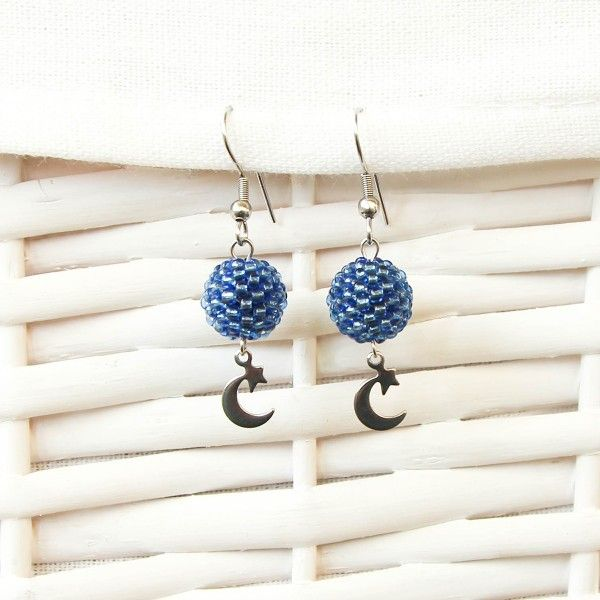 Blue beaded earrings with moon and star charm