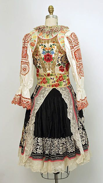 Slovak Wedding Ensemble   Traditional Slovak folk costume - 20th century - Slovak ensemble (Metropolitan museum) - backside view     Medium: (a, b, c, e, f) cotton; (d) silk   from met museum