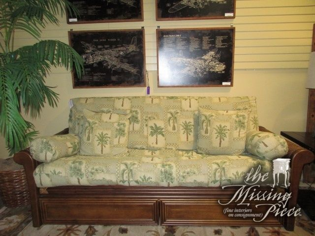 "Tropical style futon with palm patterned cushion on medium wood and rattan frame. This futon has two drawers below that are perfect for storing blankets and pillows. So comfortable as well! 87""L x 38""D x 37""H."