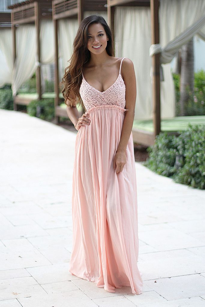 IT IS BACK! Super elegant and cute Pink Lace Maxi Dress With Open Back! Perfect for any special occasion! We love its beautiful lace flowy skirt and open back! - Lining: 100% Polyester - Dress: 100% R
