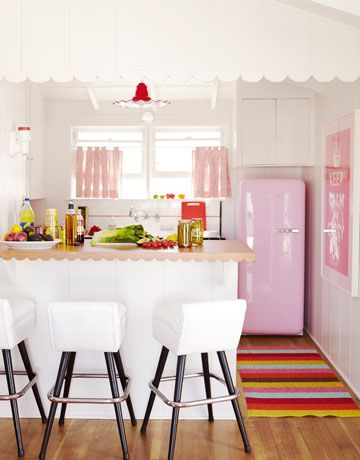 Sweet little retro style kitchen with adorable pink vintage fridge. Love the scallops on the wall and edge of the counter too!