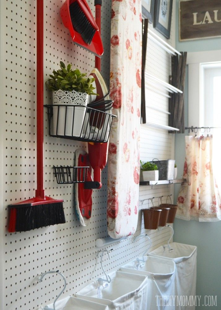 DIY aqua & red vintage inspired small laundry room design idea with a giant pegboard