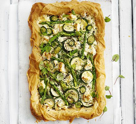 Crispy filo tart with seasonal veg. This light, zesty tart is packed with asparagus, courgette, herbs and feta. Best served al fresco