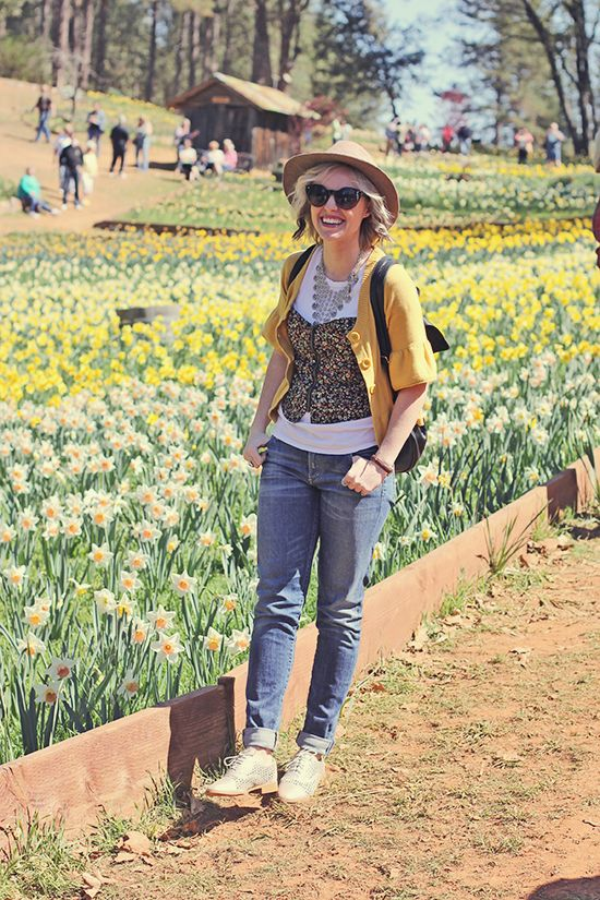 wide brimmed hat // white t-shirt // floral corset // mustard yellow sweater // cuffed jeans // silver cut out oxfords