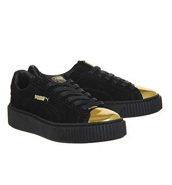 puma gold and black